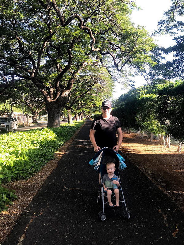 Sunset stroll with J-Babes in Honolulu, using his Cosco Umbrella Stroller.