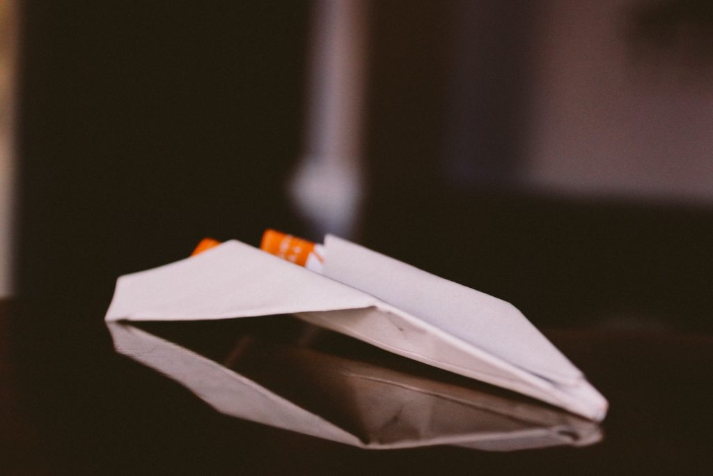 Make a paper airplane launcher with your kids